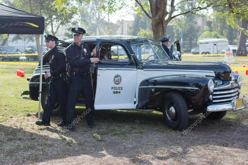 depositphotos_74030827-stock-photo-vintage-ford-police-car-on.jpg